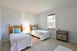 Guest room spacious enough for two twin beds