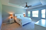 Master bedroom tray ceiling and charming bay window