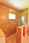 Master bath with walk-in shower and tile to the ceiling