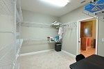 Master closet with direct access to laundry room