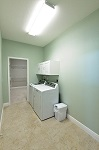 Laundry room with direct access to the master closet or garage