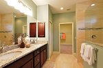 Master bath features a double vanity with granite tops and wood cabinetry