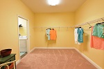 Master closet/dressing room with direct access to the laundry room