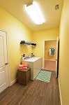 Laundry room with access to master closet, garage, and great room